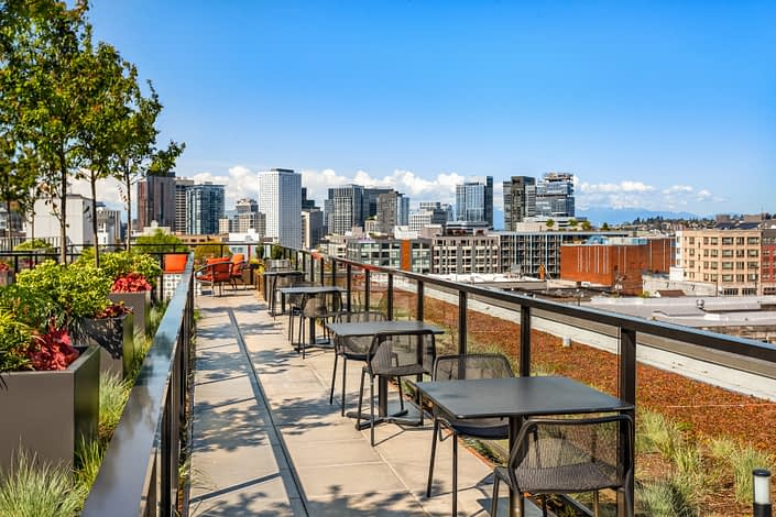 Seats and tables line the edges of the rooftop patio in Capitol Hill.